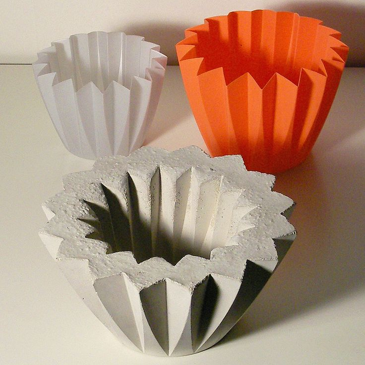 Use silicone molds for concrete planters in the garden for Concrete craft molds