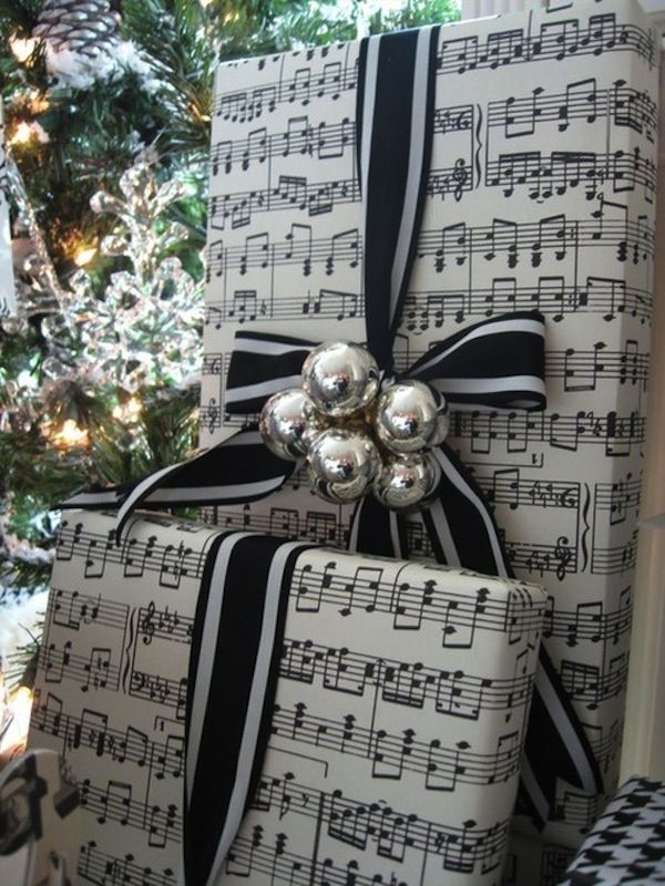 Always a vintage favorite, music themed paper is pretty with crisp black and white stripped ribbon and tiny silvery glass tree ornaments.
