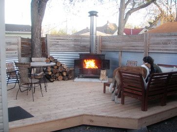 a wood stove outdoors...totally awesome idea