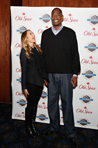 """Stacy Keibler Photos Photos - Stacy Keibler and  Dikembe Mutombo attend Dikembe Mutombo's """"4.5 Weeks To Save the World"""" Launch Event at Dave & Buster's Time Square on December 4, 2012 in New York City. - Dikembe Mutombo's """"4.5 Weeks To Save the World"""" Launch Event"""