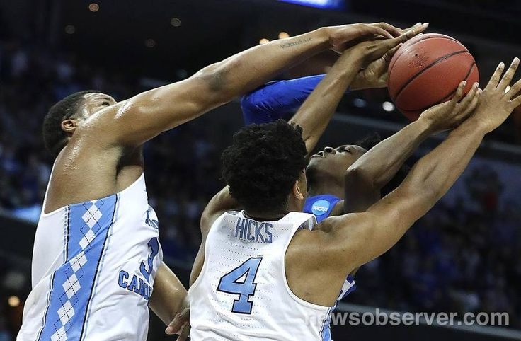 North Carolina's Kennedy Meeks (3), left, and Isaiah Hicks (4) block the shot by Kentucky's De'Aaron Fox (0) during the first half of UNC's game against Kentucky in the NCAA Tournament South Regional final at FedExForum in Memphis, TN Sunday, March 26, 2017.