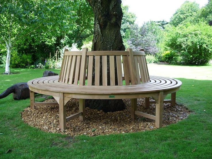garden bench around a tree a quiet place where you can relax and enjoy the garden. beautiful ideas. Home Design Ideas