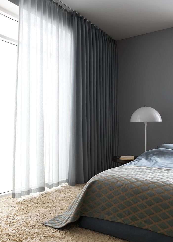 A luxurious hotel feel to this sombre bedroom. Airy inner layer and a dimout outer layer for a good nights sleep.