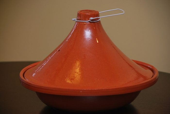 Pot for cooking Tagine – thick, clay cone resting on a rounding base.