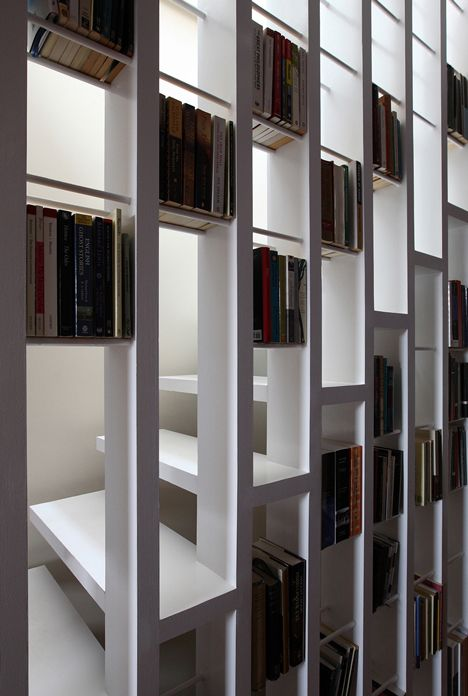 Staircase doubles as a bookcase in London loft conversion by Tamir Addadi…