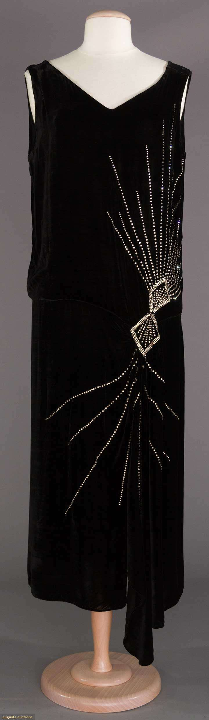 "SILK VELVET EVENING GOWN, 1920s  October 25, 2017 NYC New York City  Black velvet, 2 diamond shapes w/ rays in rhinestone, B 42"", Low W 37"", Swag L 56"", excellent."