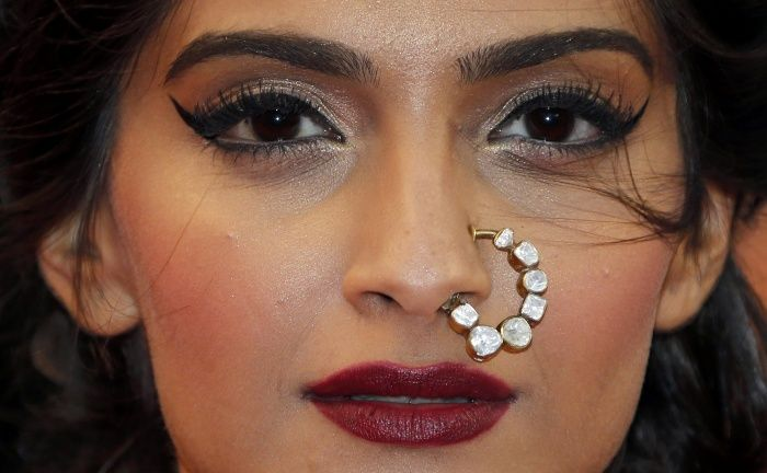 See more designs here http://www.weddingsonline.in/blog/editors-pick-bridal-nose-ring-designs-we-love/