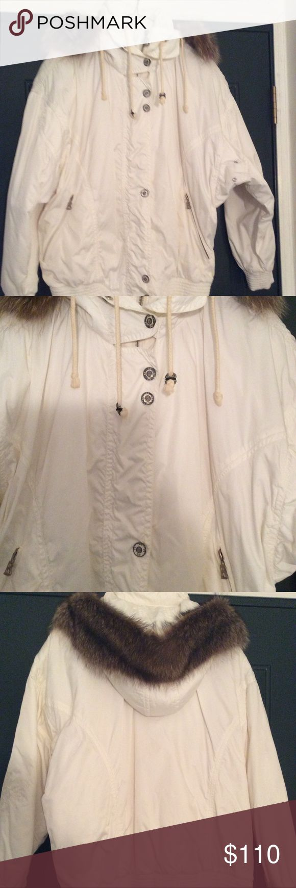 Bogner Bogner ski jacket,  attached hood,  fur on hood detaches with snaps.  Decorative B zipper pulls on front closure plus decorative B pulls on both front pockets.  Also snaps closed with decorative B snaps.  Lightweight for skiing or running around town.  Decorative stitching on both sleeves.  rivets under arm for extra venting.  Excellent condition.  Purchased in Aspen Co. Bogner Jackets & Coats