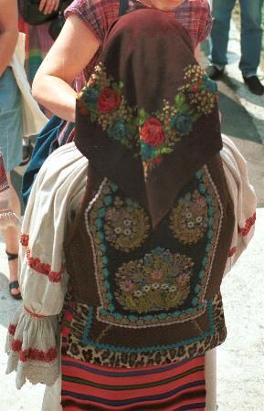 Romanian costume Năsăud - Bistriţa-Năsăud  Flared pieptar covered with brown and black velvet and edged with fur, and decorated with floral embroidery done in tiny seed beads     Photo taken Năsăud, Bistriţa-Năsăud, July 1991