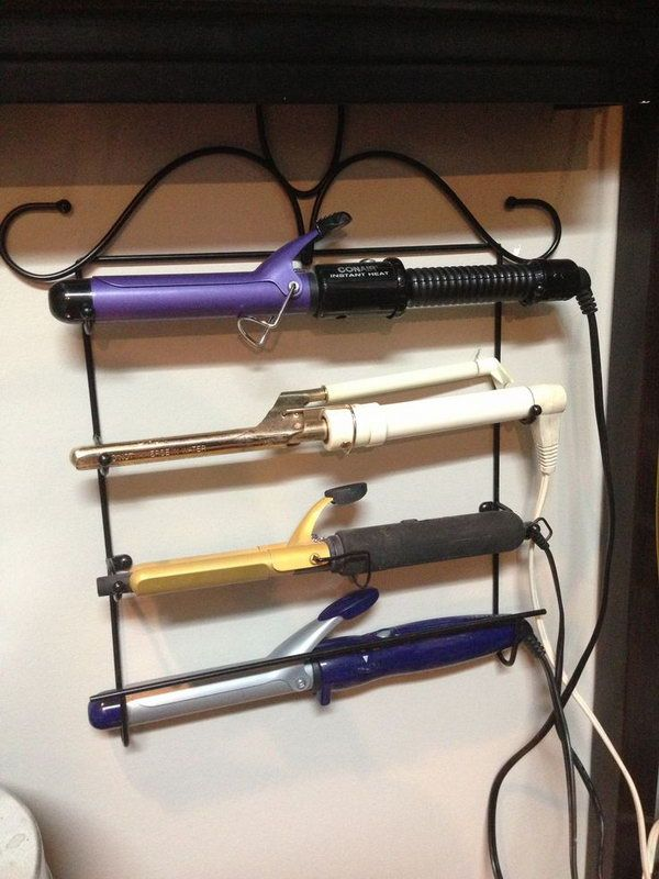 Use a rolling pin holder as a curling iron holder. Just make sure its not tol wide for your irons. http://hative.com/creative-hair-dryer-and-curling-iron-storage-ideas/