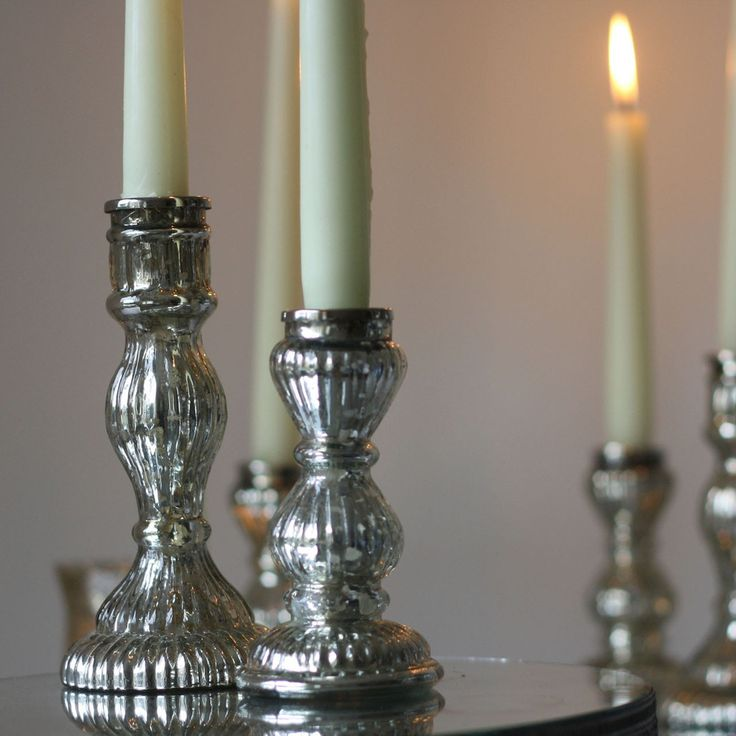 Love these - what a look!  (Candles might not survive outdoors.. need hurricanes?) mercury silver candle sticks wedding decorations