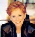 Reba Nell McEntire, country music singer and part-time actress, was born in McAlester, OK on March 28,1955 to Clark Vincent McEntire and Jaqueline (Smith) McEntire. She has three siblings, Alice, Pake and Susie.
