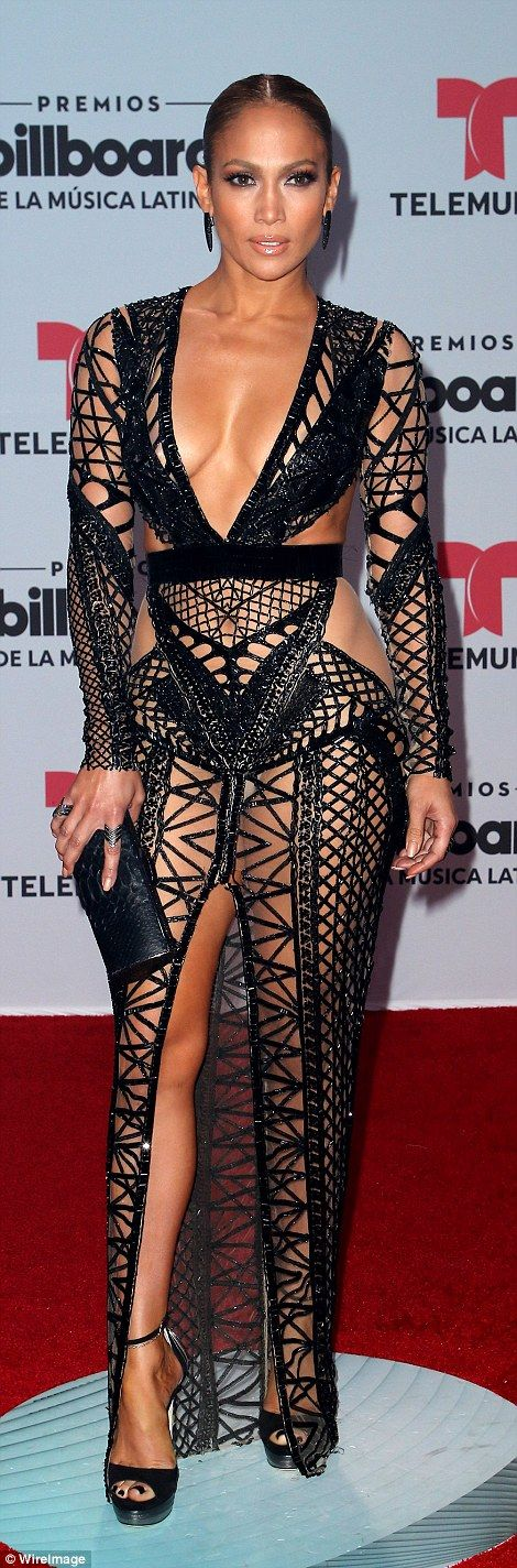 The 47-year-old singer dared to bare Thursday in a revealing fishnet dress at the Billboard Latin Music Awards in Florida.