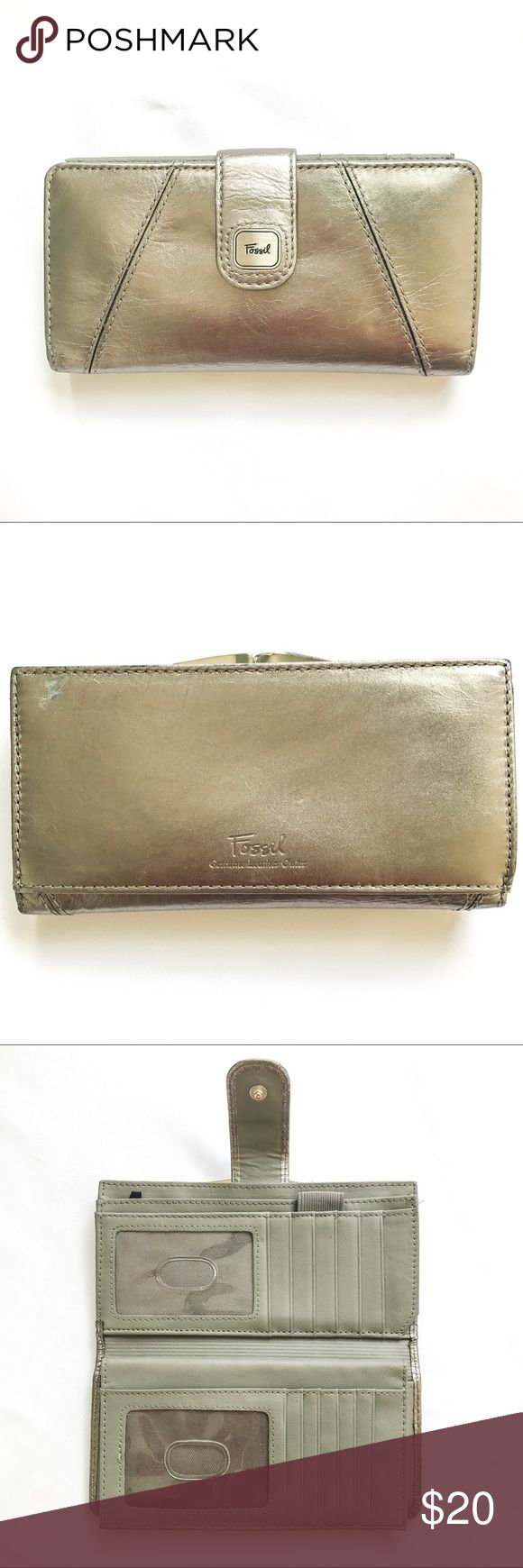Fossil wallet Silver fossil wallet.  Good condition.  Small scratch on the back on the left corner as seen in the second pic. Fossil Bags Wallets