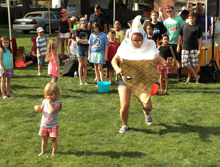 Macayla MacDougall, dressed as an ice cream cone, balances a ping pong ball during a game at National Night Out at Braintree Town Hall,Tuesday, Aug. 1, 2017.  Gary Higgins/The Patriot Ledger