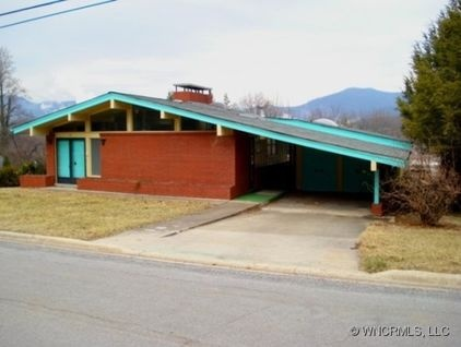 Roofline changes the whole look of a small modest house! MCM House... love the car port!