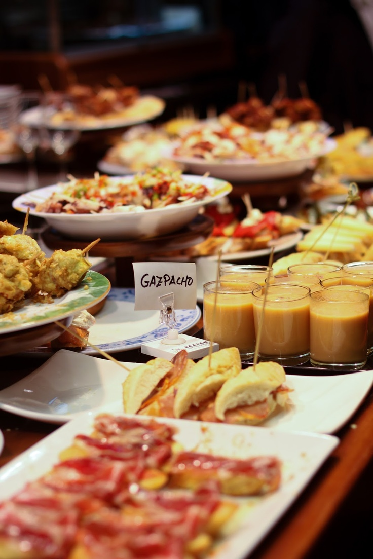 "Must do in Spain: going ""de tapeo"" The ""tapas"" (also called ""pintxos"" in the north of Spain), are small food portions. You can try some in the same bar or go ""de tapeo""."