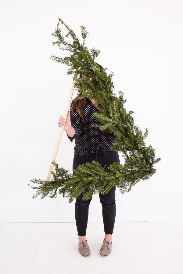 How to Make a Giant DIY Wreath (over 3 ft tall) Shaped Like a Triangle for Winter and/or Christmas. #holiday #christmas #wreath #flowers #floralwreath