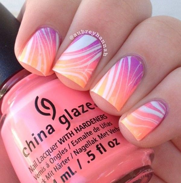 Add dram to your gradient nail art theme by adding strips of white water marble nail art polish.