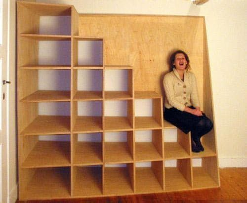 Check out this cool stair/shelving hybrid over at Materialicio.us. We like that it is a single unit and it gets wider at both the bottom and top of the stairs (aiding in stability and aesthetics!). The project comes from the Belgian site of Voet-Theuns Architecture. Painted, this could be an even more attractive piece in a small studio apartment with a lofted sleeping area. Via: Materialicio.us...