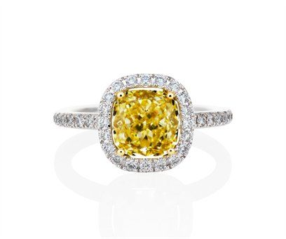 De Beers - This stunning 2.2 mm (0.09 in.) wide platinum ring is prong set with a yellow cushion-cut diamond solitaire embraced by a sparkling micropavéd halo setting.