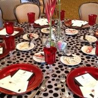 Black White Red Wedding Décor including Red Water Goblets, Red Chargers, and Black Polka Dot Tablecloth Overlays.  For sale on Weddingbee.com