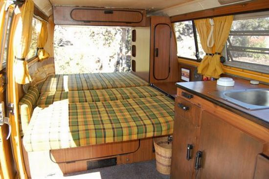This looks like a bed that folds out....might be a solution to our too small bed in our van!