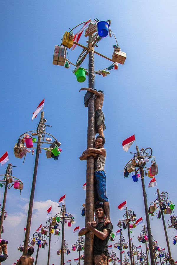 Panjat Pinang. Climb a greased bamboo pole to get prizes hung from the top. It's a traditional games festival to celebrate Indonesia's independence day in Jakarta.