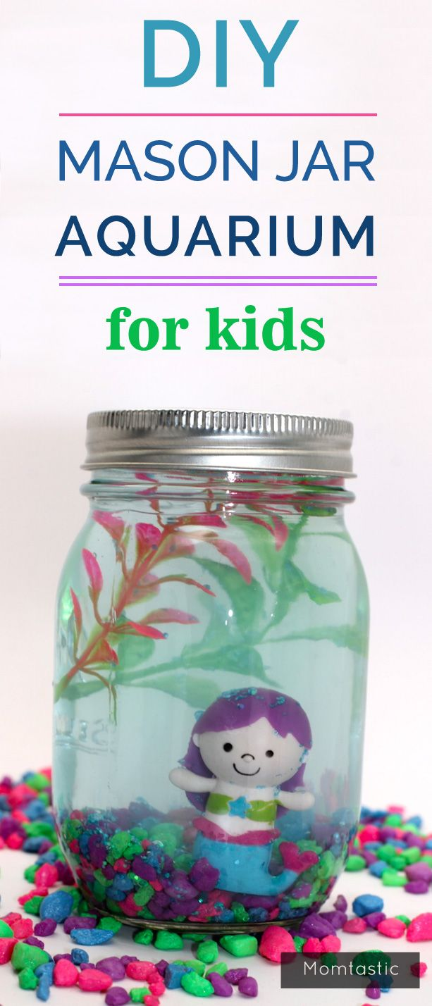 DIY Mason Jar Aquarium for Kids - This adorable little mason jar aquarium is a perfect addition to your kid's bookshelf; it's so simple to make and no maintenance is required (yay!). I stocked mine with little mermaids, but you can leave the faux animal choices up to your kids. Whether they want to stock them with fake goldfish, shark, or tigers (hey, it's a stretch, but there's really no limit), this mason jar aquarium takes only about five minutes to make, so you can quickly build up a