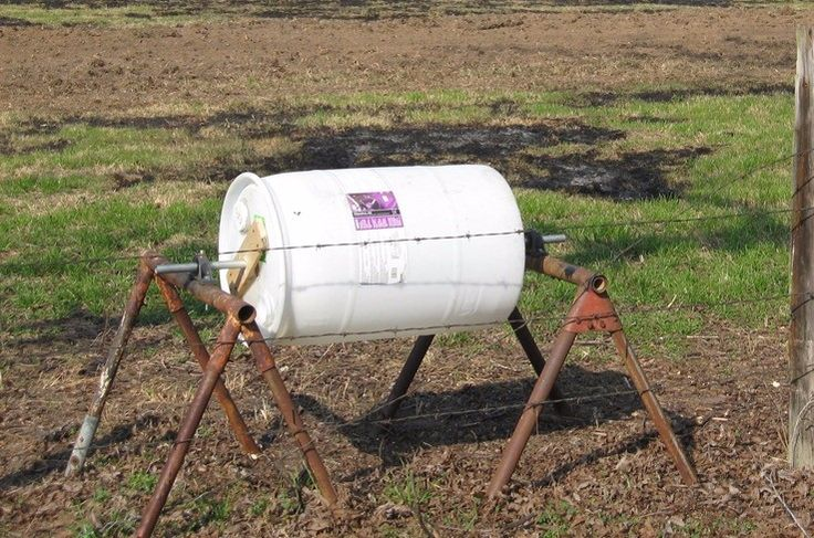 Compost Tumbler by Kate -- Homemade compost tumbler constructed from a 55-gallon plastic drum, pipe, hinges, and surplus bearings. www.homemadetools...