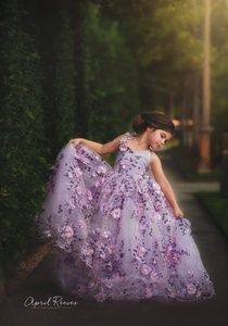 Gorgeous 3d lace gown with elasticised back, lace-up straps for adjustable fit, floral accents running down one strap, floor long skirt in shades of lavender, pink and purple, and tulle underskirt for volume and shape. The gown will fit girls sizes 6-7.Model photos courtesy of April Reeves Photography and Michelle Selesnik.