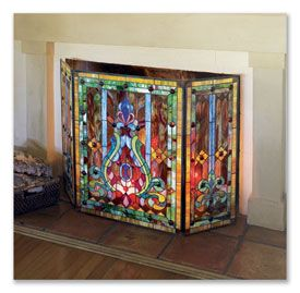 STAINED GLASS FIRESCREEN Handcrafted and soldered with 541 pieces of art glass in our three panel design with hinged metal frames.