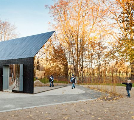 Unusual building with reflective facade designed by MLRP architects.
