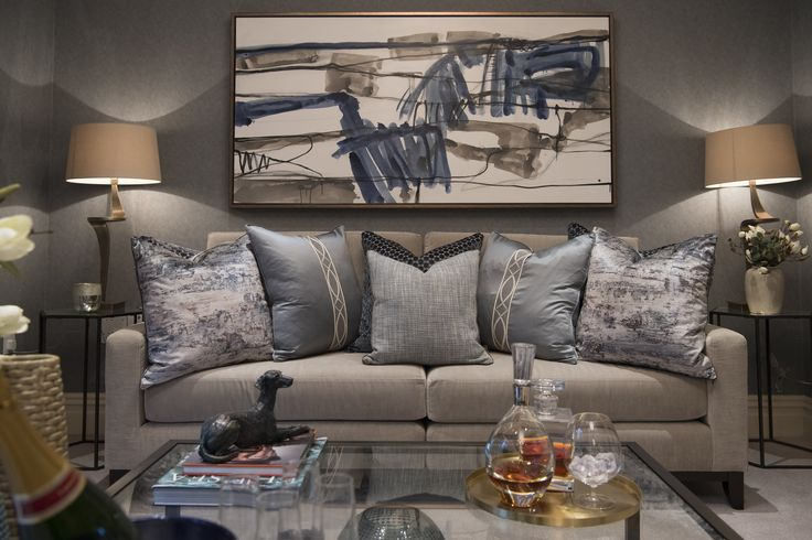 A stunning focal point in our Buckinghamshire project's drawing room; the contrasting patterns and textures of the velvet cushions in metallic effect lure you into this sumptuous sofa with Chatworth fabric by @Olivia_Bard - the pale blue hue complimenting the artwork that sits above. #interiordesign #luxurylife #luxury #london #luxuryproperty #luxuryhomes #londonproperty #luxuryinteriors