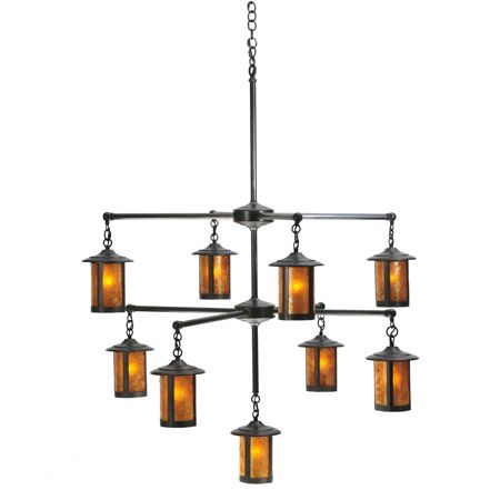 This nine light craftsman chandelier features round shades made of amber mica.