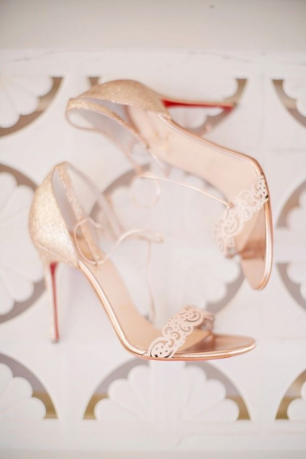 Gilded perfection: http://www.stylemepretty.com/2015/07/12/30-christian-louboutin-shoes-youll-love-almost-as-much-as-your-husband/