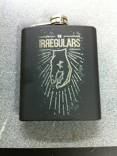 engraving on powder coated flask reviling the metal under, very nice result! by umake for the Irregulars.
