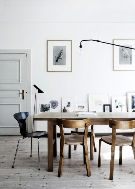 A Stockholm interior, photographed by Line T. Klein: Alvar Aalto dining chairs model 68 (1935) and Arne Jacobsen Tongue chair (1955). / Line...