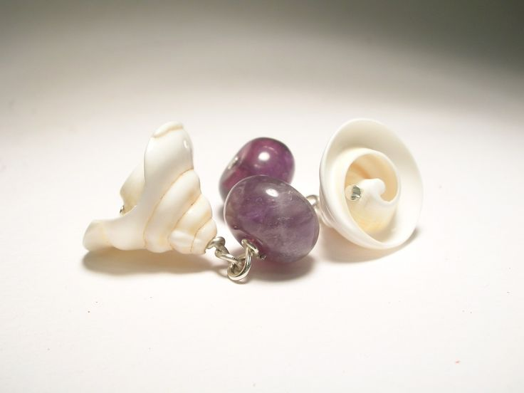 Cufflinks with conical shell and amethyst