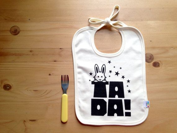 Ta Da! This baby bib is totally magical! Featuring one of our best loved designs, the T has been turned in to a top hat for the rabbit to pop out