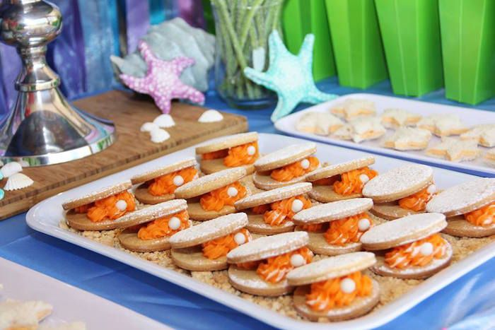 Clam shell cookies from Ariel + The Little Mermaid Birthday Party at Kara's Party Ideas. See it all at karsapartyideas.com!