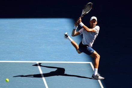 Australian Open: Djokovic and Wawrinka Win After Injury Layoffs
