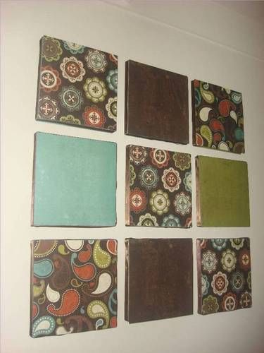 Cheap and easy wall art. Using scrapbook paper (or in my case, vintage calendar pages), mount to foam board and hang.