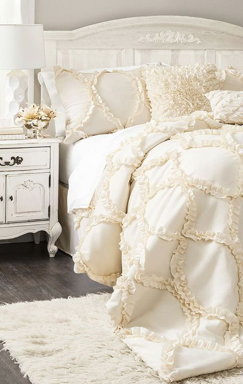 I like this for a little girls room,add splash of color with maybe a light turquoise or mint,or even light coral throw pillows  Bedroom. White bedding. texture bedding. white furniture