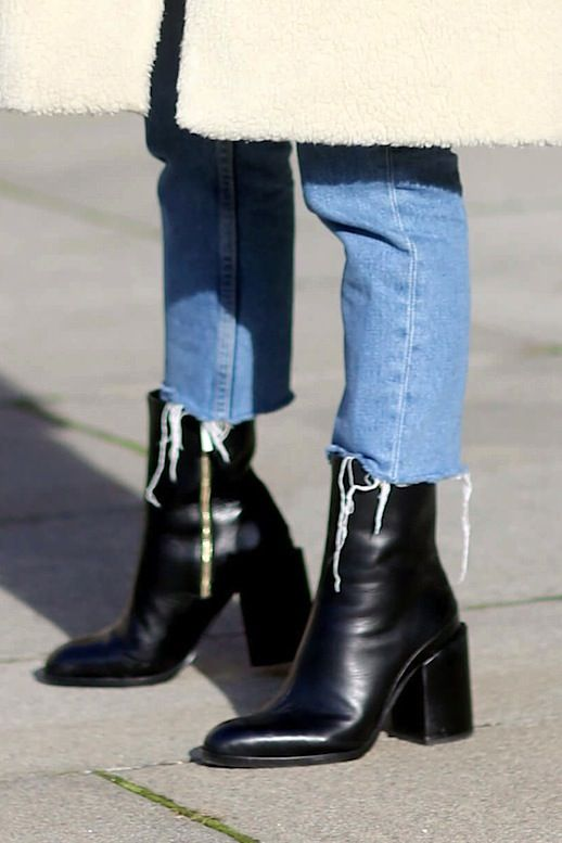 Jessie Bush proves just how cool the cropped raw-hem jeans and tall ankle boot trend looks this season. We also love the extra bit of texture her shearling coat lends to the look. The best part is that you can pull off this jeans and boots combo with any denim wash and ankle boot color. Just make sure the boot hits right underneath the hem of the jeans.