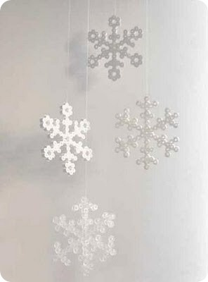 Delicate snowflakes made from Hama Perler.