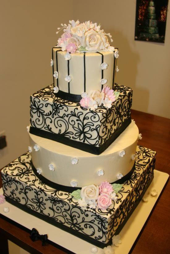 The Francesca-Buttercream wedding cake with gum paste flowers.