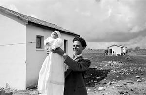 Israel. 1951. First child born in the settlement of Alma. Eliezer Trito is in charge of the pipeline construction work which is going to bring water from a source 3 miles away. He is seen here with Miriam, the daughter he had with his wife Miriam.