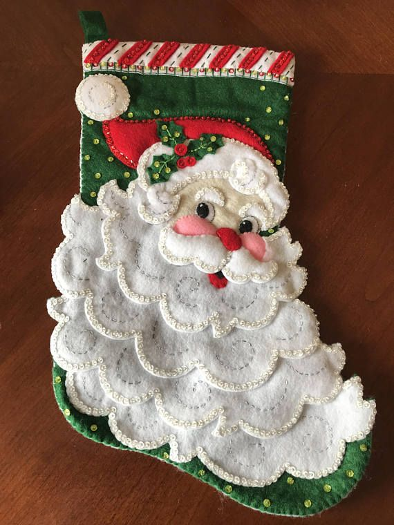 """St. Nick stocking measures 18"""" from top to bottom. Fill with goodies from Santa and place next to your fireplace or close by your Christmas tree. St. Nick stocking comes lined to prevent damage to stitches when filled. If you would like it personalized include the name at checkout to"""