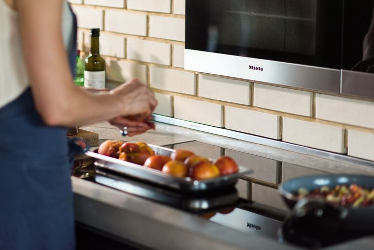 Learn from professional kitchens and create zones in your kitchen for optimum ease of use. A good layout will allow tasks to be carried out practically and safely, ensuring that you're not turning across the line of traffic with hot pans etc. Grouping of tall elements, wet areas, tea and coffee preparation will help to reduce 'clashes' of users. If the working area is too narrow (any less than 1m), then there may be a bit of ballet involved when two or more people are in the space